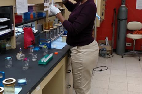 student testing water sample in lab