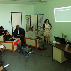 Ariel Trocino delivers a PowerPoint presentation to a small group in Grenada.