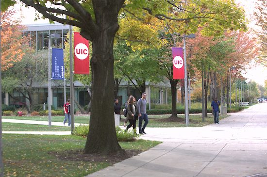 Students walk across UIC's campus on a fall day.