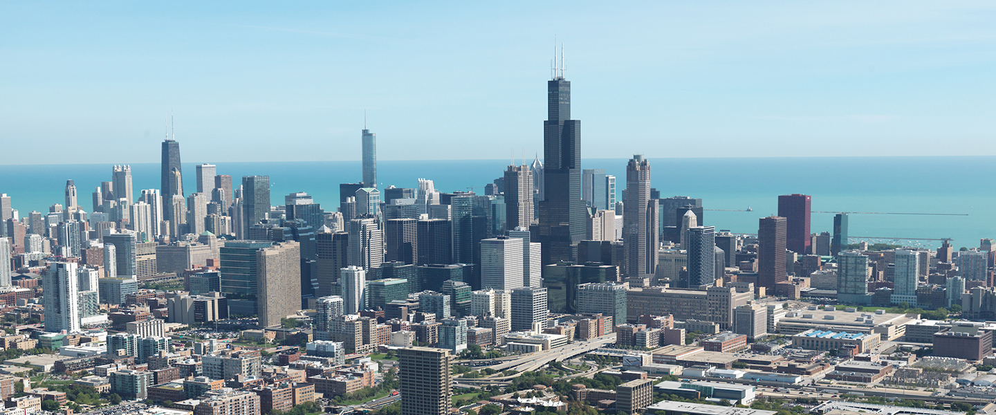 An aerial view of the Chicago skyline, with UIC's University Hall in the foreground.