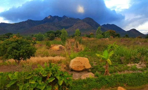 A mountain is framed by stormclouds in Malawi.