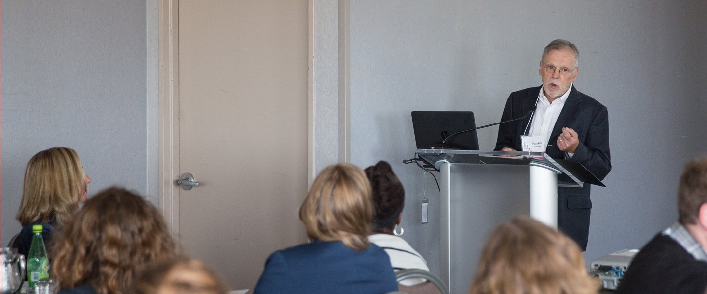 Dr. Patrick Lenihan delivers a lecture during a DrPH class meeting.