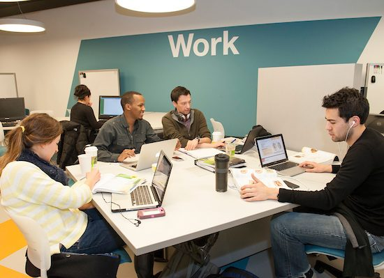 Students study and work together on an assignment at a designated study area within the UIC Library.