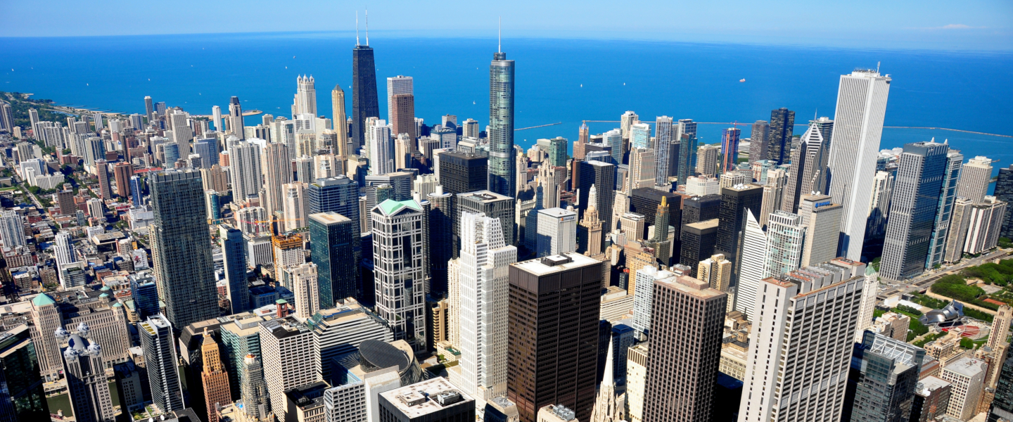 An aerial view of the Chicago skyline, with Lake Michigan in the background.