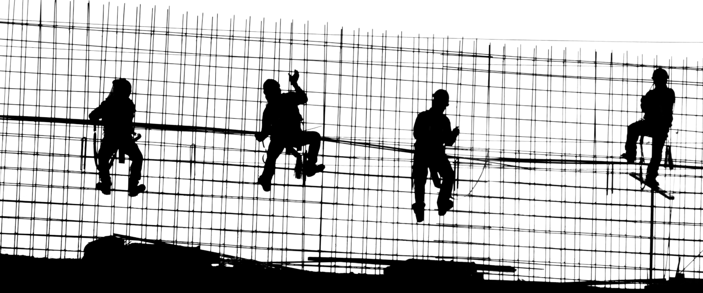Construction workers climb wire scaffolding working on a project in Mexico.