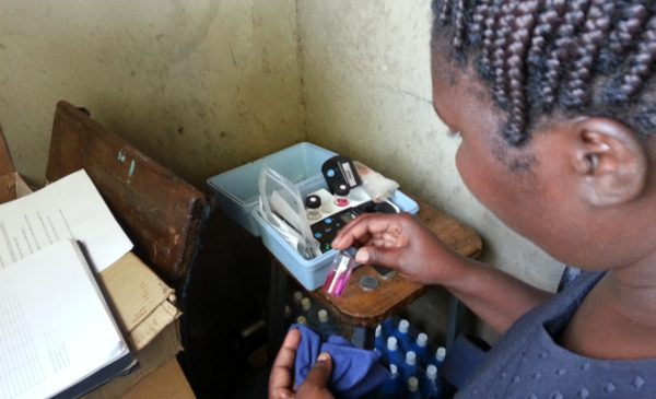 MPH student Obehi Ilenikhena tests water purification systems during her applied practice experience in Kenya.
