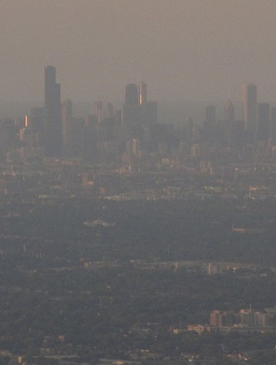 An aerial view of the Chicago skyline shrouded in smog.