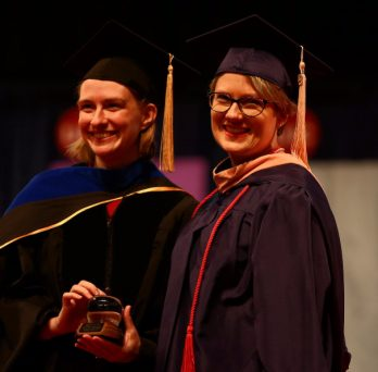 A student receives an award at the 2018 Commencement ceremony.