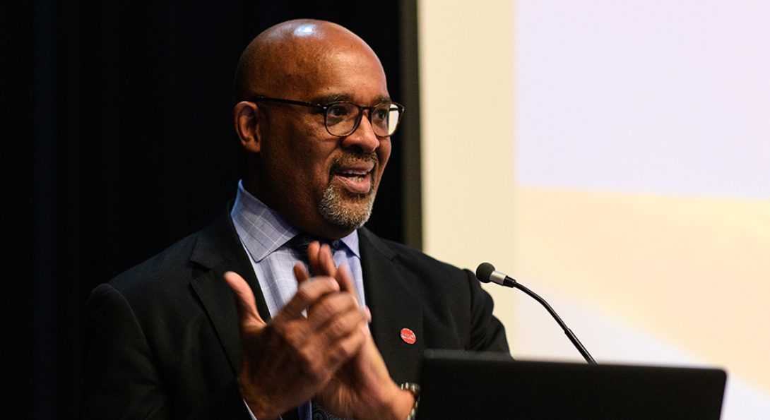 Dean Wayne H. Giles speaks at a podium during Research and Practice Awards Day 2019.