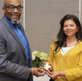 Nytzia Licona accepts her volunteer award at an awards ceremony.