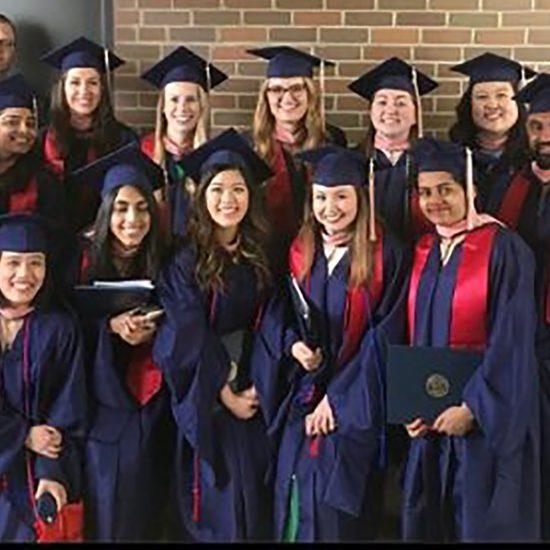 MHA graduates pose for a photo.