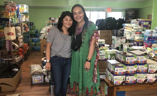 MPH students Kimberly Silva and Gabrielle Lodge pose for a picture standing in front of supplies they transported to Mississippi.