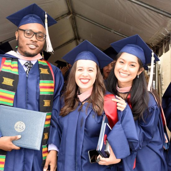 Graduating students from the Class of 2019 pose for a picture outside the Credit Union One Pavilion.