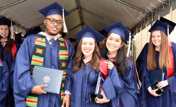 Graduates pose for a photo outside the UIC Pavilion at the conclusion of the Commencement ceremony.