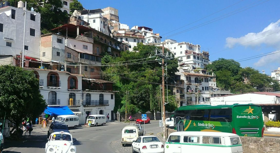 A street with car traffic and buildings along the side, in Cuernavaca, Mexico.