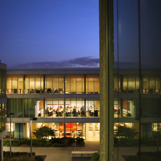 A view of UIC classrooms in Douglas Hall at night.