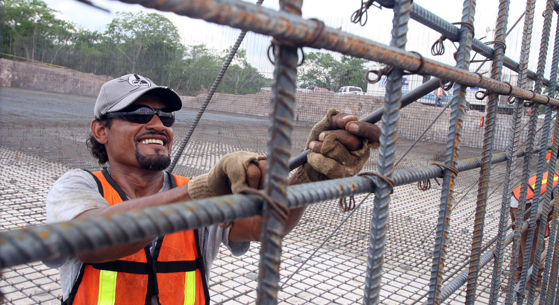 A worker assembles rebar at a water treatment plant.
