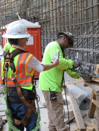 Alumna Barb Epstein monitors decibel levels at a work site.