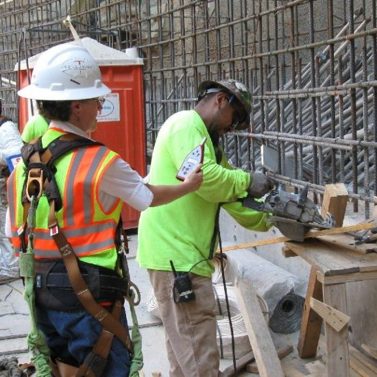 Alumna Barb Epstein monitors decibel levels at a work site.