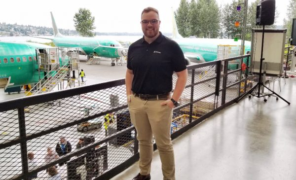 Benjamin Tate poses for a photo at Boeing's Everett, Washington plant.