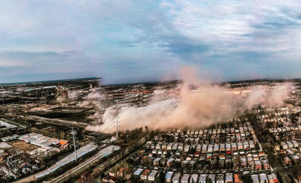 An aerial view of the demolition of a smokestack at the Crawford Generating Station, which generated a plume of dust that diffused through Chicago's Little Village neighborhood.