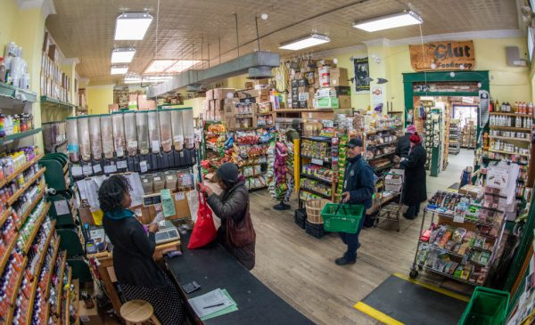 A grocery store in Seattle, with a cashier checking out a customer's items.
