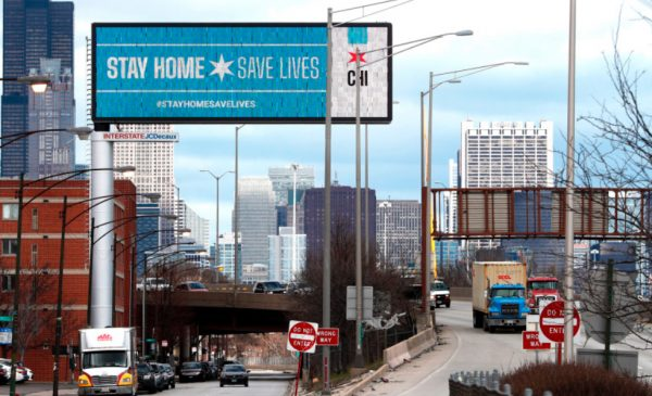 A Chicago billboard alongside Interstate 90/94 states: Stay Home, Save Lives.