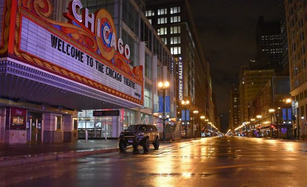 State Street in Chicago is dark and devoid of traffic during the COVID-19 shelter-in-place.