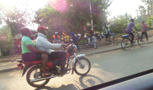 Passenger on a Bodaboda and a Bicycle