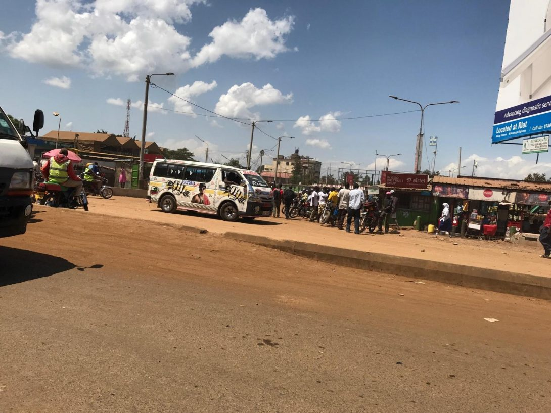 (Busy matatu (bus/van) station in the city center.)