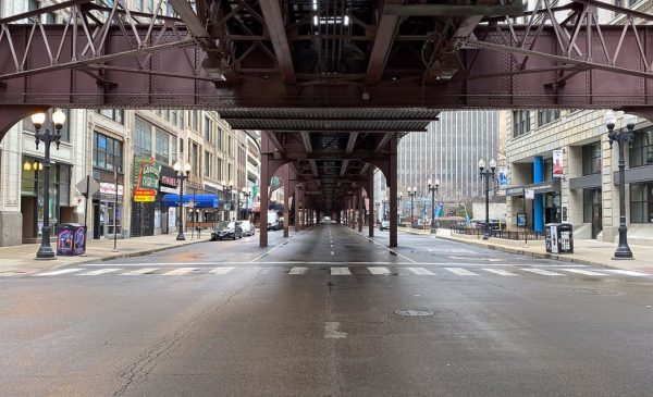 Wabash Avenue in Chicago, under the L tracks, is devoid of traffic during COVID-19 shelter-in-place orders.