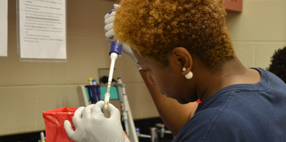 A student at the UIC School of Public Health uses a pipette to test a water sample from Lake Michigan.