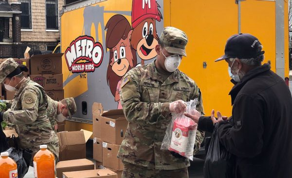 Members of the New York National Guard help distribute food to residents during the COVID-19 pandemic.