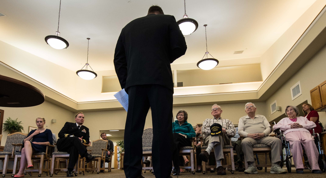 Chief Master-at-Arms Mark Durben, from Coshocton, Ohio, attached to Naval Magazine Indian Island, speaks at a Veterans Day ceremony at Seaport Landing Retirement and Assisted Living in Port Townsend, Wash.
