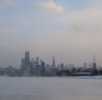 Fog rises from a frozen Lake Michigan and envelopes the Chicago Loop during the 2014 polar vortex.
