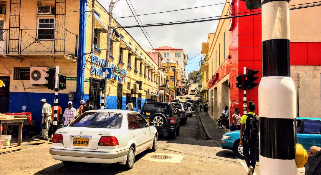 Cars drive through an intersection on Granby Street in St. George, the capital of Grenada.