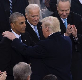 President Donald Trump shares a moment with outgoing President Barack Obama and Vice President Joe Biden at the 2016 inauguration.
