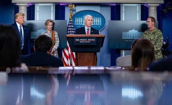 Vice President Mike Pence speaks at a podium during a Coronavirus Task Force press briefing.