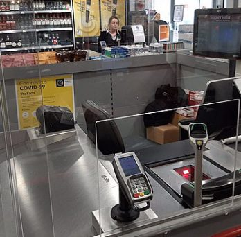 A checkout lane and conveyer belt in a grocery store.
