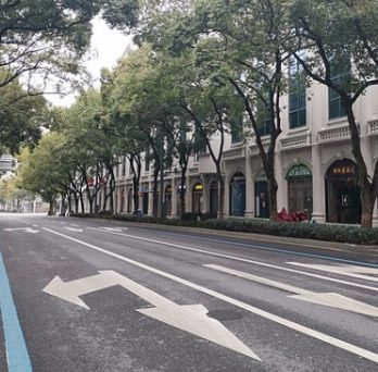 A street in Wuhan, China, devoid of any vehicle traffic or pedestrians during a government-ordered stay-at-home phase.