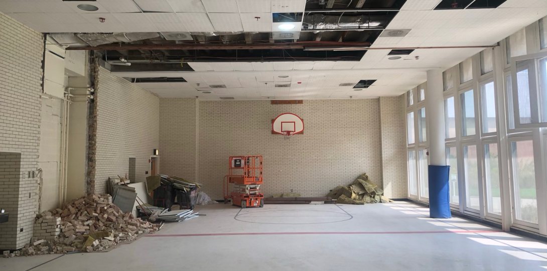 Bricks lay on the floor of the old gym as renovation work begins.