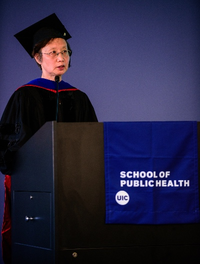 An Li speaks from a podium at the investiture ceremony.