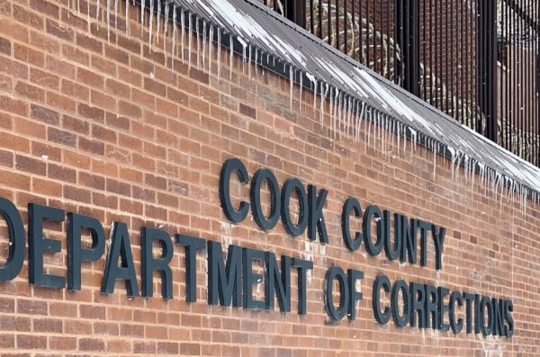 A brick wall and sign denoting the Cook County Department of Corrections.