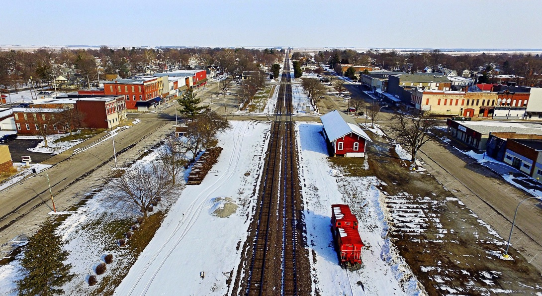 An aerial view of the town of Bushnell, Illinois, bisected by railroad tracks.