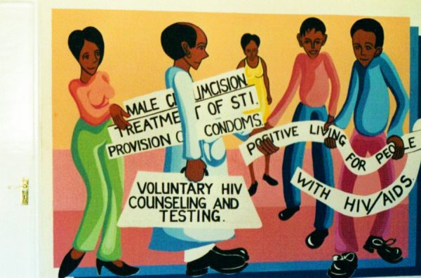 A mural in Kisumu promotes use of condoms and circumcision to prevent HIV transmission.