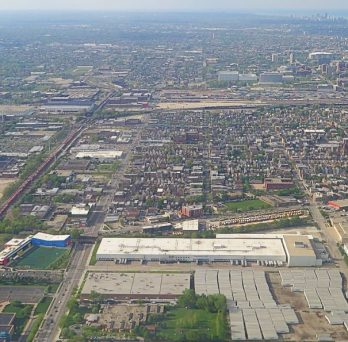 An aerial view of industries and railroads across the southwest side of Chicago
