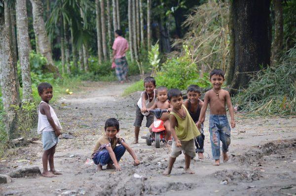 Children play along a rural street in Bangladesh.