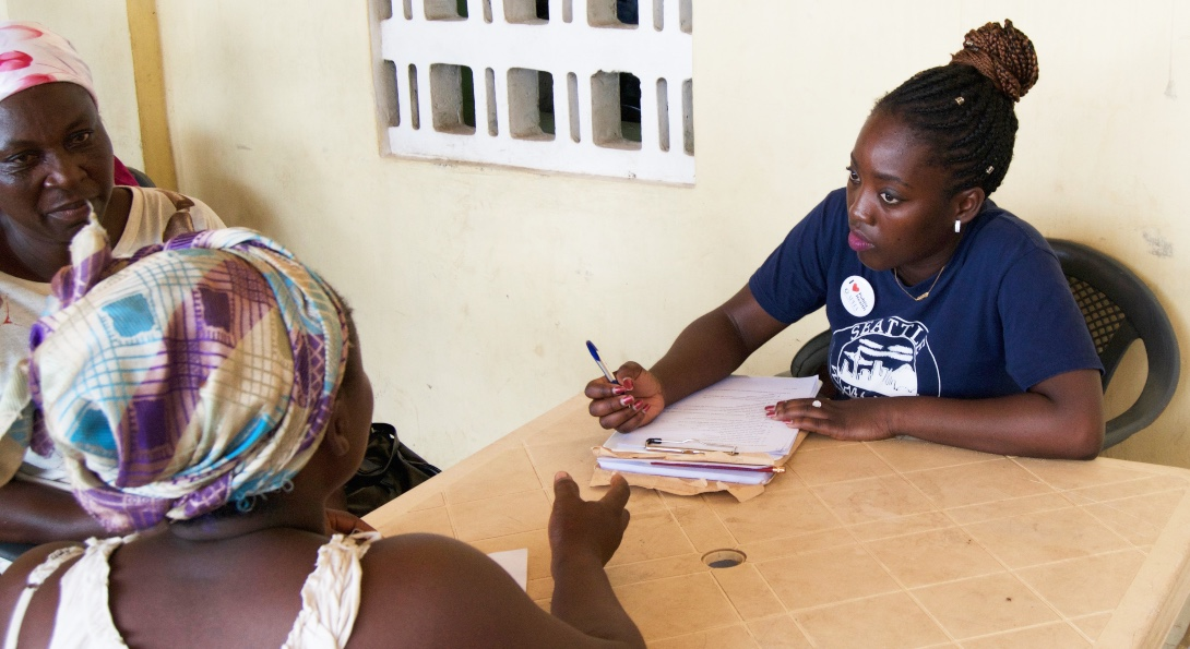 SPH student Mary Otoo conducts an interview with a woman in Kisumu, Kenya.