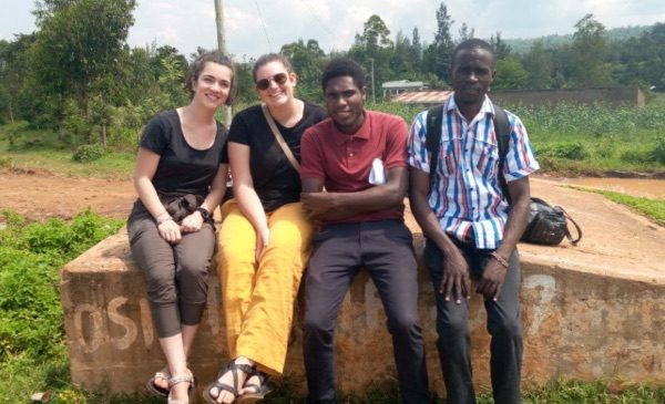 SPH students engaged in fieldwork in Kenya pose for a photo with Kenyan colleagues.