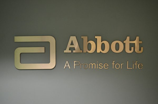 An exterior sign for Abbott Laboratories, stating a slogan: